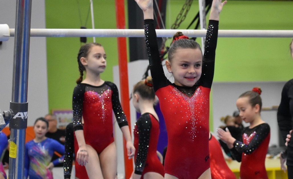 young girl at gymnastics team competition at Schafer Sports Center