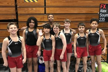 young boys gymnastic team group photo during competition at Schafer Sports Center