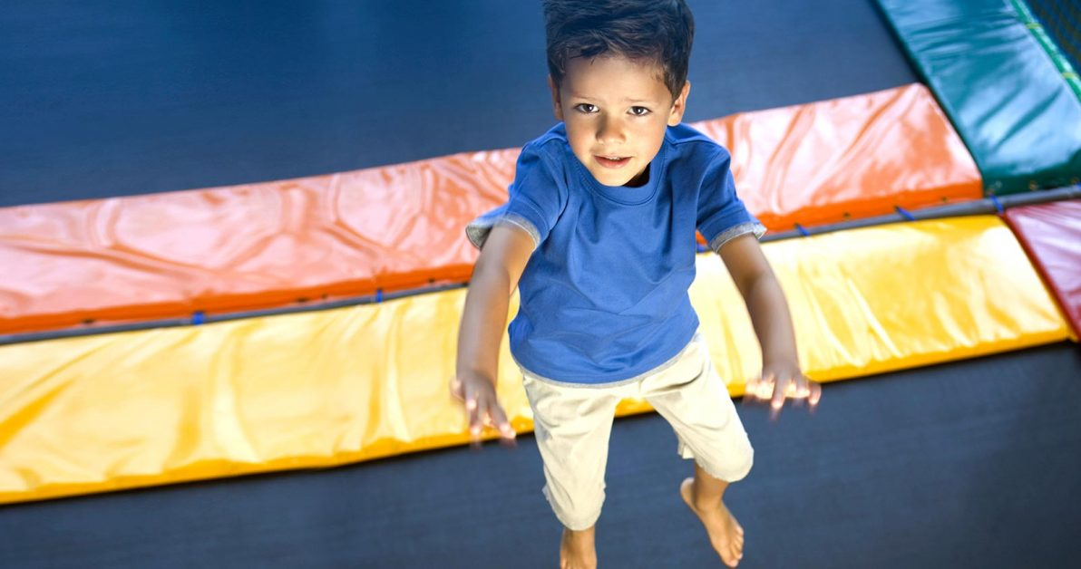 young boy jumping on trampoline at Schafer Sports Center