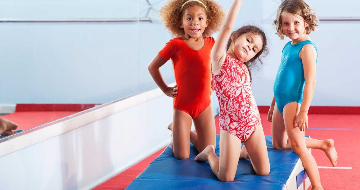 3 young girls in gymnastics room during school's out camp at Schafer Sports Center
