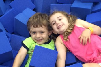 smiling boy and girl playing in gymnastics foam pit at Schafer Sports Center in New Jersey
