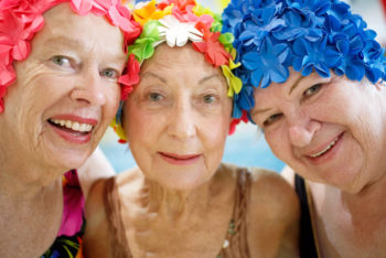 3 smiling adult women at Schafer Sports Center for Adult Swim Class